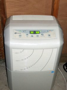 A dehumidifier in a home in Staten Island, NY